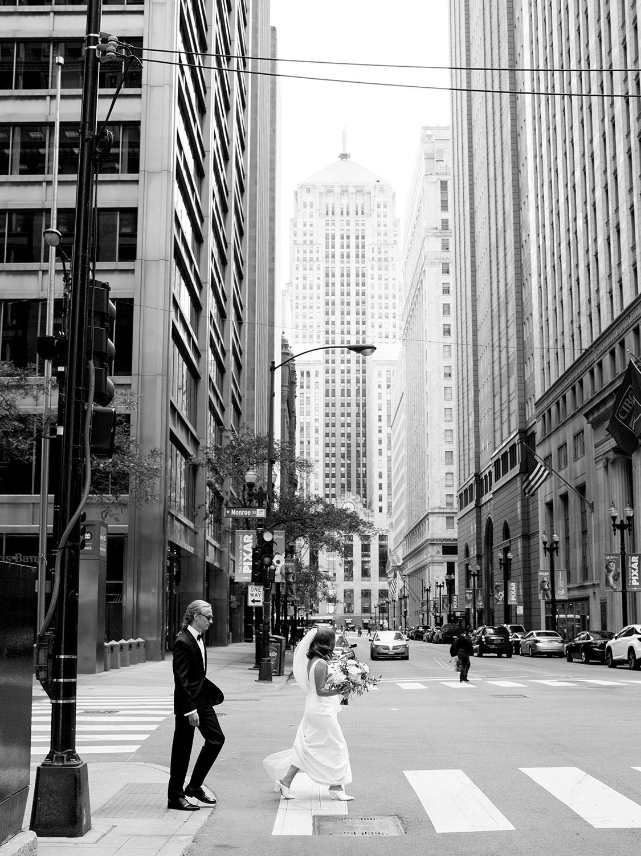 couple walking on Lasalle street in chicago