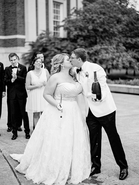 bride sabering a bottle of champagne
