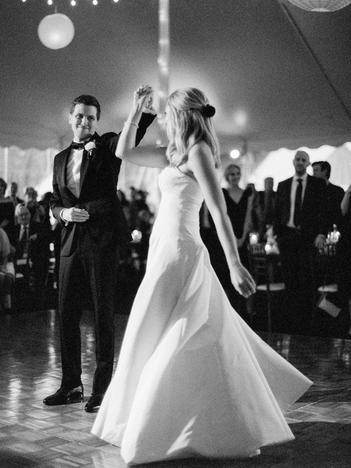 first dance during a tent reception at a conway farms golf club wedding in lake forest illinois