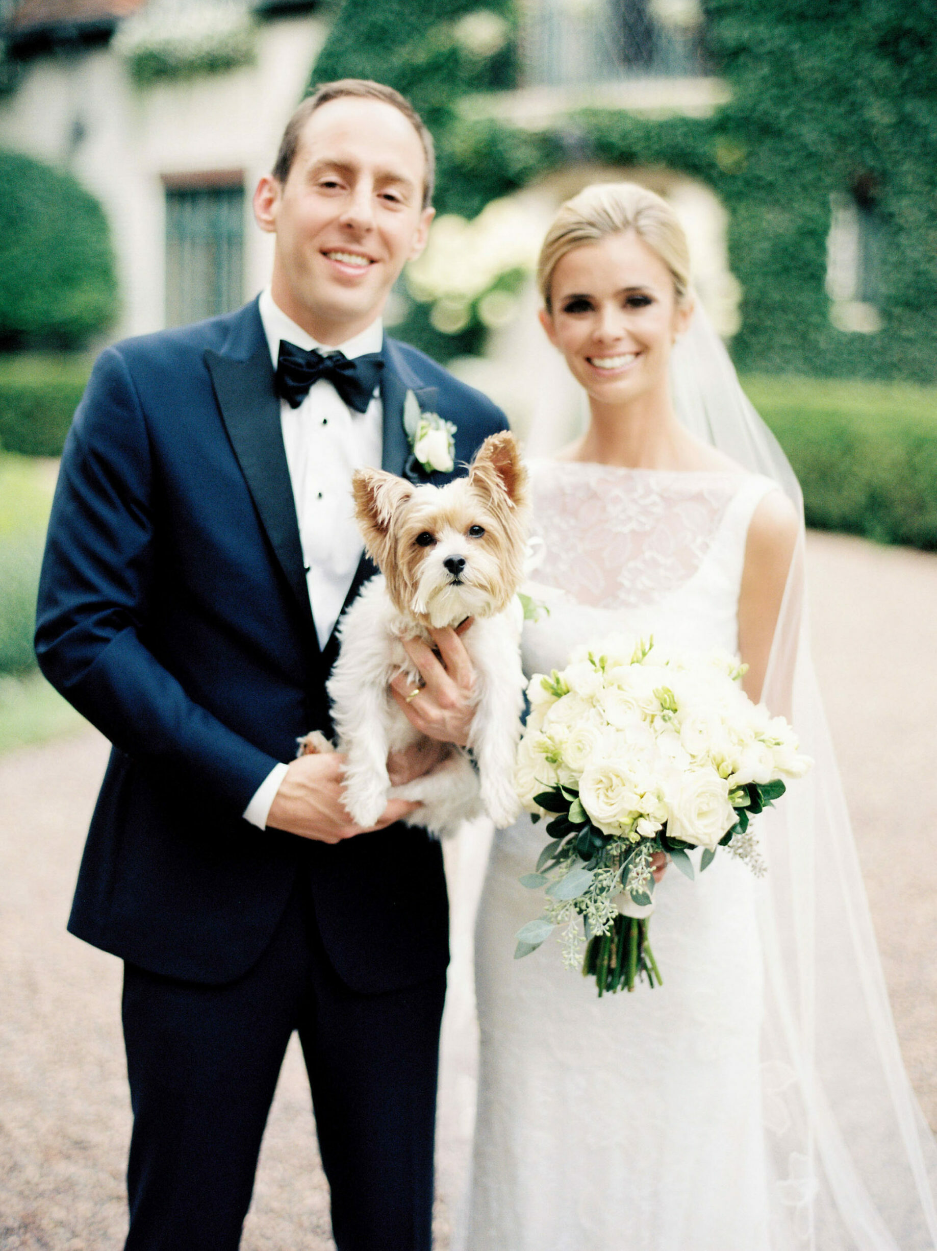 film wedding photos of couple with dog at a lake forest backyard wedding